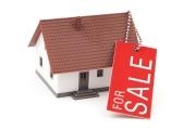 Firmy obchodující s nemovitostmi by rády dosáhly zrušení daně z nemovitostí